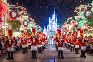 """Toy soldiers parade down Main Street, U.S.A., at Magic Kingdom during """"Mickey's Once Upon a Christmastime Parade."""" The festive processional is one of the happy highlights of Mickey's Very Merry Christmas Party, a night of holiday splendor with lively stage shows, a unique holiday parade, Holiday Wishes: Celebrate the Spirit of the Season nighttime fireworks, and snow flurries on Main Street, U.S.A. The special-ticket event takes place on select nights in November and December in Magic Kingdom at Walt Disney World Resort in Lake Buena Vista, Fla. (Ryan Wendler, photographer)"""